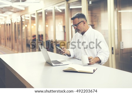 Businessman using his laptop and phone in the middle of nowhere Stock photo © photography33