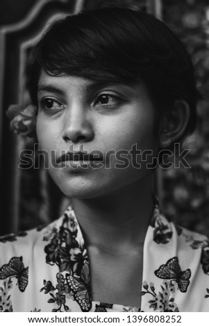 dark-haired woman closing her eyes and a flower on her ear lying on her belly Stock photo © wavebreak_media