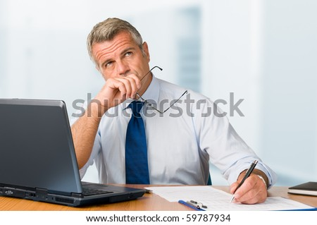 Portrait of an office worker with the hand on his chin against a white background Stock photo © wavebreak_media