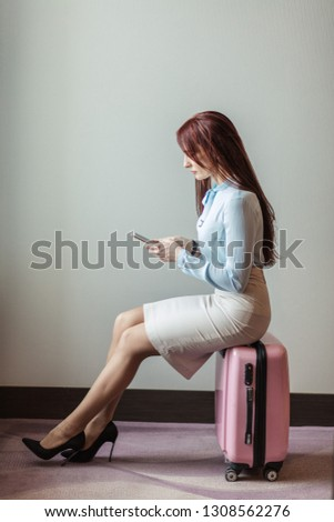 Profile of a businesswoman smiling with a suitcase against white background stock photo © wavebreak_media