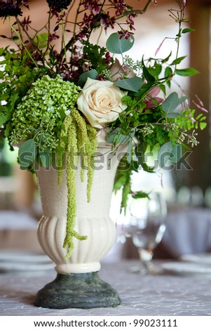 A floral wedding centerpiece on a table during a catered event Stock photo © nuiiko