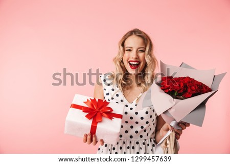 beautiful blond girl with a bouquet of red roses over crystal cl stock photo © nejron