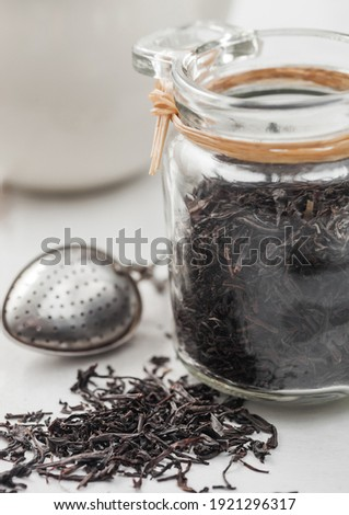 Dry tea and wooden spoon with ceramic jar Stock photo © punsayaporn