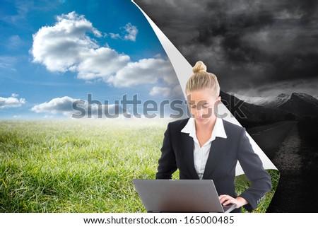 composite image of businesswoman using laptop stock fotó © wavebreak_media