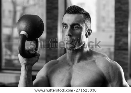 Black and white portrait of a bodybuilder holding kettle ball Stock photo © deandrobot