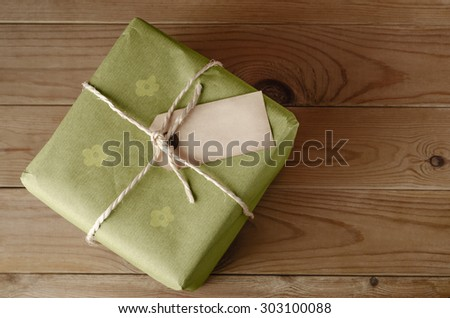 String Tied Parcel with Label and Green Floral Wrapping Paper Stock photo © frannyanne