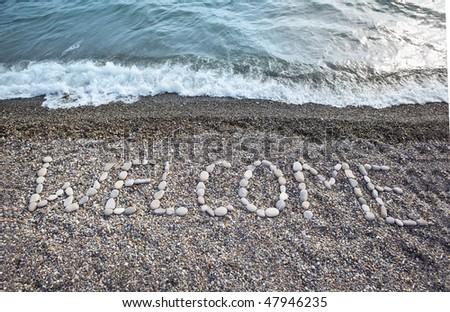 opschrift · stenen · welkom · kust · strand · water - stockfoto © paha_l