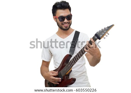 focused handsome young guitarist playing electric guitar with amplifier stock photo © deandrobot