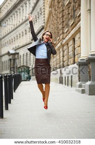 Elragadtatott üzletasszony ugrik öröm beszél okostelefon Stock fotó © vlad_star