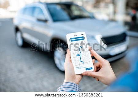 Woman using mobile application for car parking in underground ga Stock photo © stevanovicigor