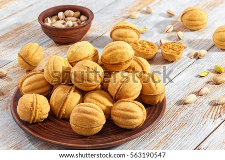 Delicious cookies with condensed milk and walnuts. Russian Traditional winter dessert Stock photo © frimufilms