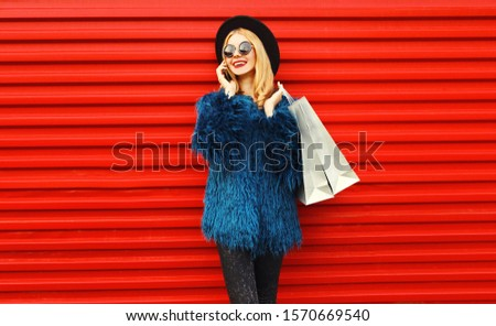 fashion woman in fur coat lady portrait talking on cell phone i stock photo © victoria_andreas