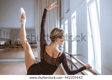 The young modern ballet dancer posing against the room background Stock photo © master1305