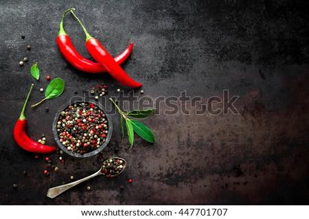 red hot chili pepper corns and pods on dark old metal culinary background Stock photo © yelenayemchuk