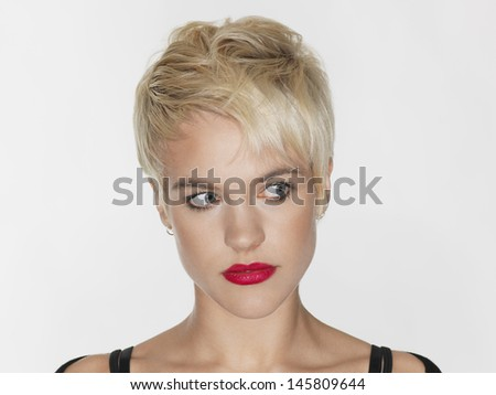 headshot of beautiful model with red lips and blonde short hair stock photo © julenochek