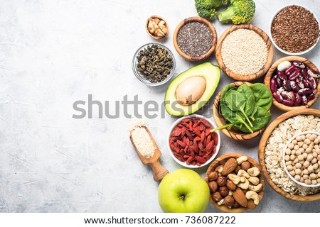 Healthy food ingredients background. Vegetables,herbs and cutting board on wooden background. Top vi Stock photo © Virgin