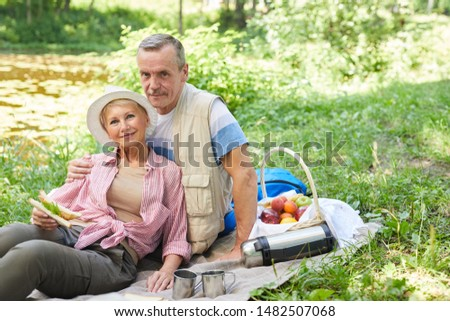 Couple in love looking what they have for picnic in basket, wonderful rest Stock photo © motortion