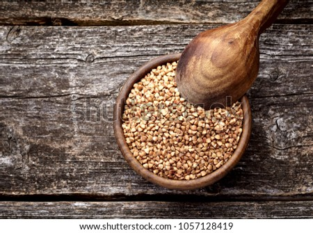 buckwheat in wooden bowl and spoon groats in wood dish and shov stock photo © maryvalery