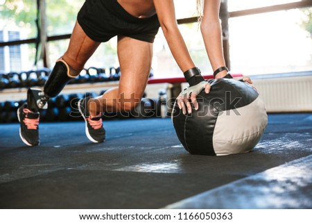 Portrait of sporty handicapped girl 20s with prosthesis in track Stock photo © deandrobot