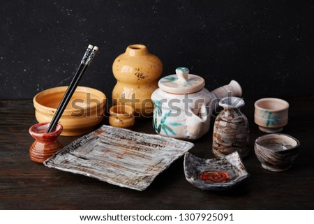 set of empty ceramic dishes for sushi and rolls on a black stone table stock photo © dash