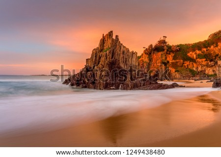 beautiful sunrise light at bingie beach with soft motion flows stock photo © lovleah