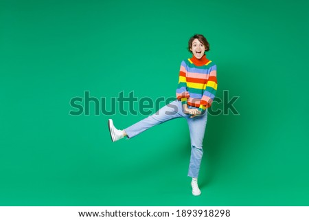 Full length image of delighted woman 20s wearing casual clothing Stock photo © deandrobot