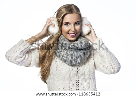 Portrait of cheerful woman wearing ear muffs and scarf rejoicing Stock photo © deandrobot