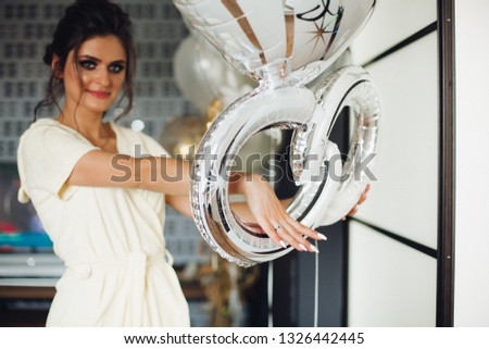 Brunette bride showing hand with wedding ring and hiding face. stock photo © studiolucky