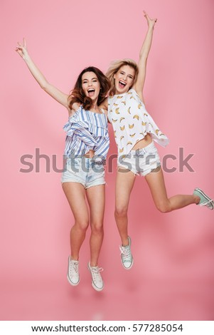 Young woman isolated over grey background showing okay gesture. Stock photo © deandrobot