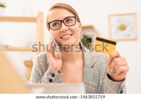 ストックフォト: 幸せ · エレガントな · 女性実業家 · 眼鏡 · 注文