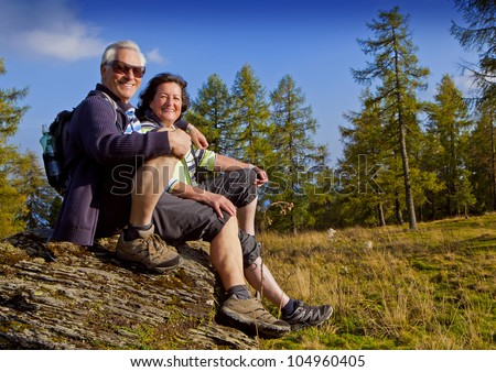 Pensioners in sunglasses in the autumn forest. Pensioners like gangsters Stock photo © galitskaya