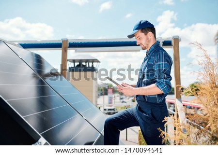 young master with tablet searching for online data about solar panels stock photo © pressmaster