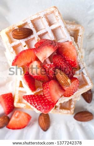 Belgium waffers with sugar powder, strawberries, almonds and cho Stock photo © marylooo