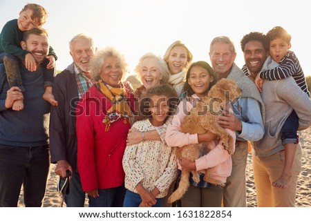 Front view of happy multi-generation family with american flag standing on beach in the sunshine Stock photo © wavebreak_media