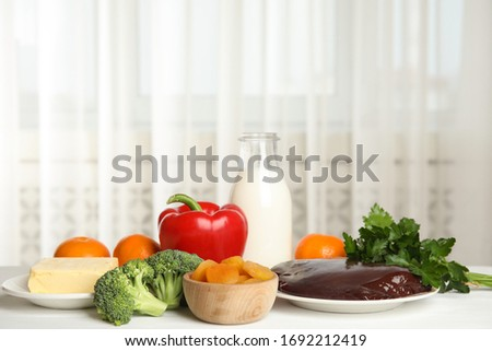 Assortment of foods for healthy liver on white wooden background.  Stock photo © Illia
