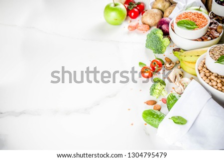 selection food rich in fiber on white wooden background around empty plate stock photo © illia
