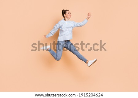 Pretty young woman in blue jeans and beige sweater holding paperbags Stock photo © pressmaster