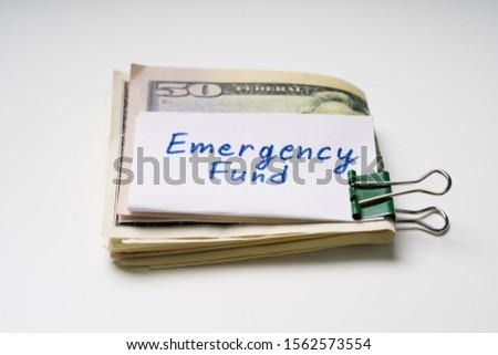 Pliées cinquante dollar urgence fonds Photo stock © AndreyPopov