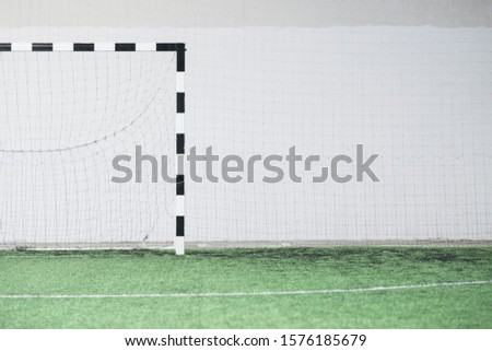 Part of empty football field, gates and net against white wall on stadium Stock photo © pressmaster