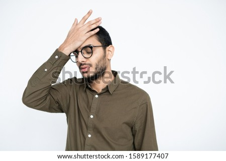 Embarrassed businessman in eyeglasses keeping his hand on forehead in isolation Stock photo © pressmaster