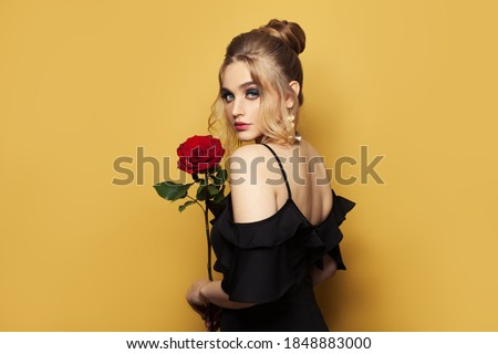 Pretty young blond female in black evening dress holding glittering disco ball Stock photo © pressmaster