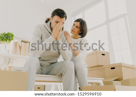 Stressful family couple forced to move home because of financial problems, woman complaining about s Stock photo © vkstudio