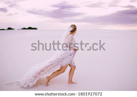 A woman bride in a white long wedding dress alone in the photo at the top of the mountain. Copy spac Stock photo © ElenaBatkova