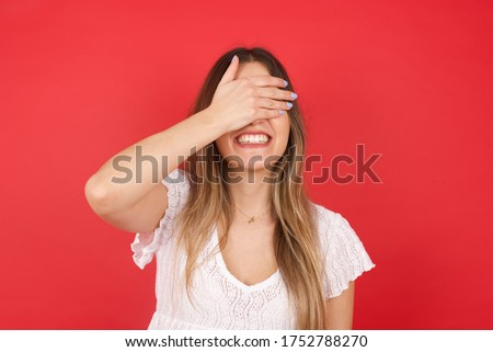 Stock photo: Positive happy surprised Caucasian woman sees something unbelievable, keeps hands on cheeks, opens m