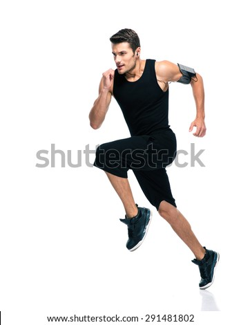 Full length portrait of young sports man running on a treadmill at gym Stock photo © GVS
