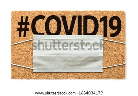Welcome Mat With Medical Face Mask and #COVID19 Text Amidst The  Stock photo © feverpitch