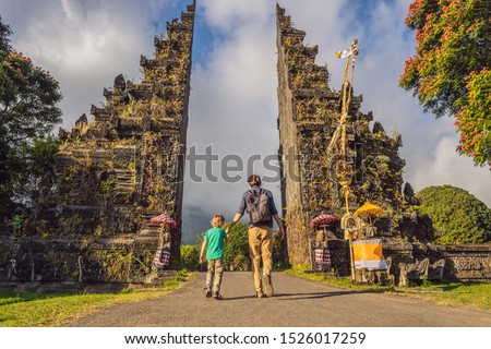 Father and son walking through Traditional Balinese Hindu gate Candi Bentar close to Bedugul, Bratan Stock photo © galitskaya