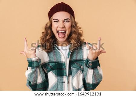 Photo jeune femme hurlant doigts Photo stock © deandrobot