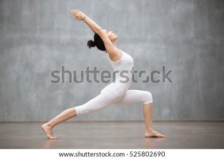 Woman doing yoga asana Virabhadrasana 1 - Warrior pose outdoors Stock photo © dmitry_rukhlenko