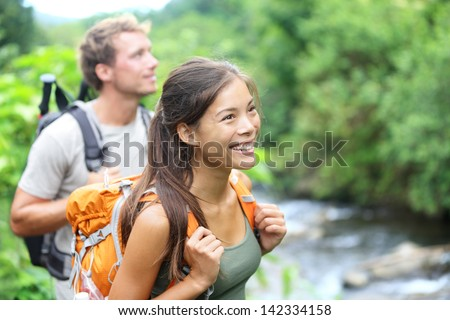 Hiker woman backpacker hiking with backpack in Hawaii mountains on Waihee ridge trail, Maui, USA. Hi Stock photo © Maridav